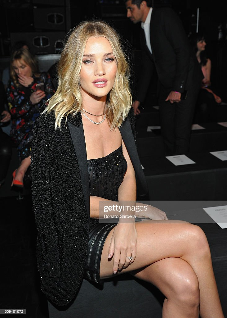 Model Rosie Huntington-Whiteley, in Saint Laurent by Hedi Slimane, attends Saint Laurent at the Palladium on February 10, 2016 in Los Angeles, California for the Saint Laurent Los Angeles show.