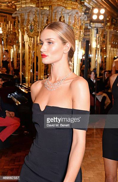 Model Rosie HuntingtonWhiteley walks the runway at the GRACE debut and AW14 dinner at Cafe Royal on February 15 2014 in London England