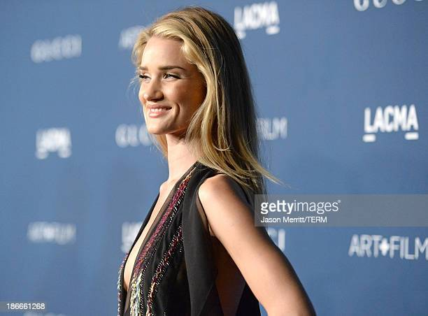 Model Rosie Huntington-Whiteley, wearing Gucci, attends the LACMA 2013 Art + Film Gala honoring Martin Scorsese and David Hockney presented by Gucci...