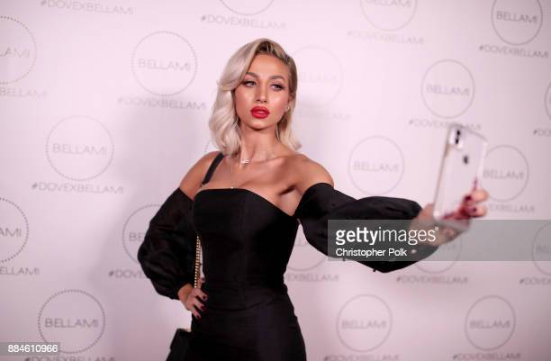 Model Roz attends the Dove x BELLAMI Collection launch party hosted by Dove Cameron and BELLAMI Hair at Unici Casa Gallery on December 2 2017 in...