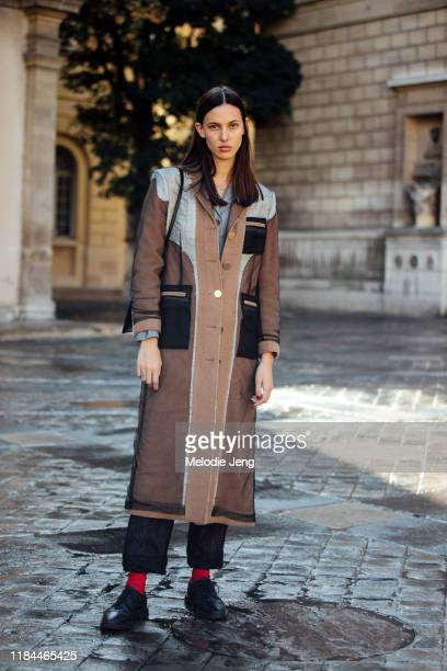 Model Ruby Aldridge wears a brown insideout/patchwork coat Thom Brown pants and black brogues after the Thom Browne show during Paris Fashion Week...
