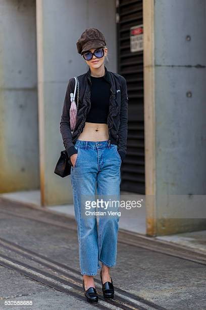 SYDNEY AUSTRALIA MAY 19 Model Ruby Jean Wilson wearing a black cropped shirt blue denim jeans hat and loafers at MercedesBenz Fashion Week Resort 17...