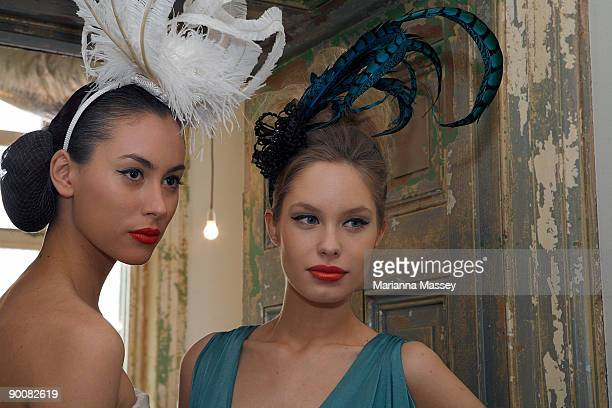 Model Ruby wearing an Ivory dress by Akira and model Ania wearing a turquoise dress by Leona Edmiston pose at the launch of Melbourne GPO's 'Fashion...
