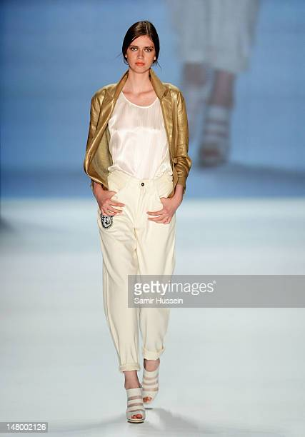 A model runs the catwalk during the Francesca Liberatore Show at MercedesBenz Fashion Week Spring/Summer 2013 on July 7 2012 in Berlin Germany