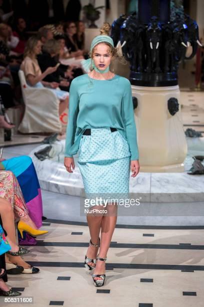 A model runs the runway at Anja Gockel fashion show during MercedesBenz Berlin Fashion Week Spring/Summer 2018 at Adlon Hotel in Berlin Germany on...