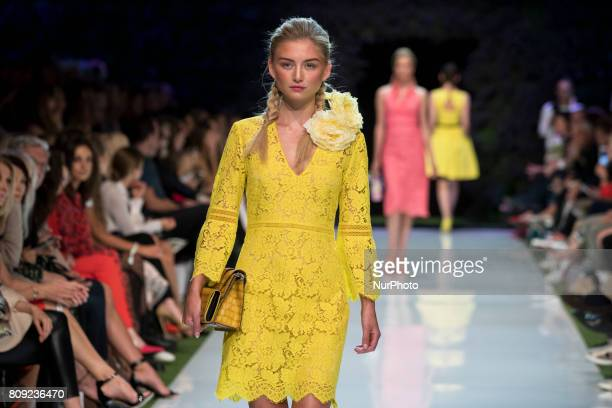 A model runs the runway at Marc Cain Spring/Summer 2018 fashion show at EWerk in Berlin Germany on July 4 2017