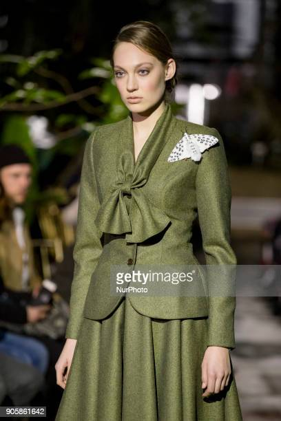 A model runs the runway at the Lena Hoschek Fashion Show at the Botanic Garden during the Berlin Fashion Week in Berlin Germany on January 16 2017