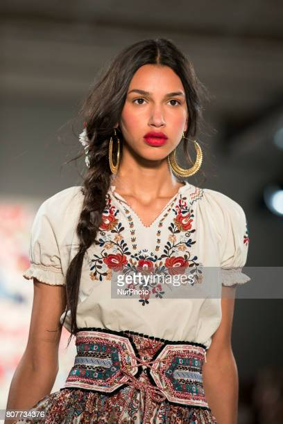 A model runs the runwy at Lena Hoschek fashion show during the MercedesBenz Berlin Fashion Week Spring/Summer 2018 at Jandorf Kaufhaus in Berlin...