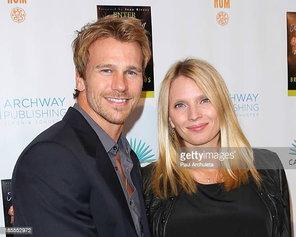 Model Rusty Joiner and his wife Charity Walden attend the launch party for Brian Edwards' new book Enter Miss Thang at Cafe Habana on October 21 2013...