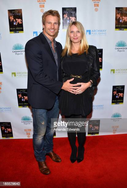 Model Rusty Joiner and his wife Charity Walden Joiner arrive at the Enter Miss Thang book launch party hosted by Cindy Crawford at Cafe Habana on...