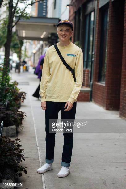 Model Ruth Bell in a purple Yoohoo cap yellow Force 5 Watersports Nantucket longsleeve shirt blue jeans and white Vans slip on sneakers after the...