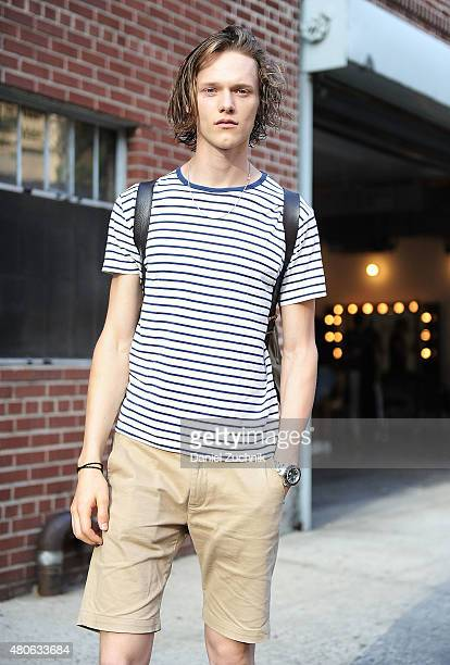 Model Ryan Keating age 22 from Canada is seen outside the Carlos Campos show wearing a Sunspel shirt Butterfly Caught pants and Adidas sneakers...