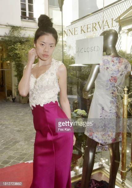"""Model Sabrina aka Gan Yajian wears a dress by Anne Kervall during Anne Kervall Ready to wear """"De Luxe"""" Spring/Summer 2021/2022 Fashion Show Hosted by..."""