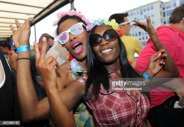 Model Sadia De Kiden and Stephanie Simbeck attend the Christopher Street Day gay pride parade on the P1 truck on July 19 2014 in Munich Germany