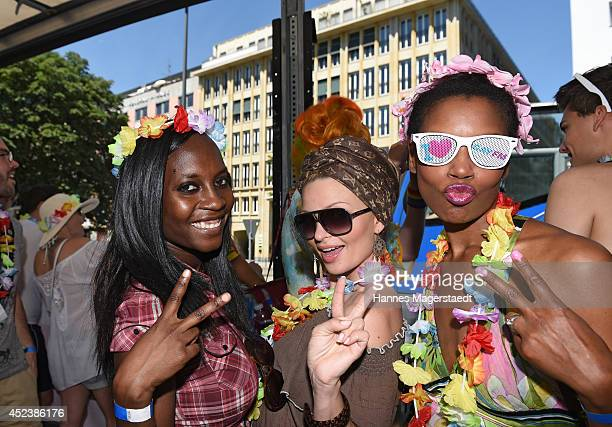 Model Sadia De Kiden Belinda Gold and Stephanie Simbeck attend the Christopher Street Day gay pride parade on the P1 truck on July 19 2014 in Munich...