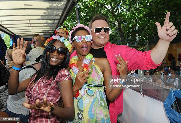 Model Sadia De Kiden Stephanie Simbeck and Markus Mensch attend the Christopher Street Day gay pride parade on the P1 truck on July 19 2014 in Munich...