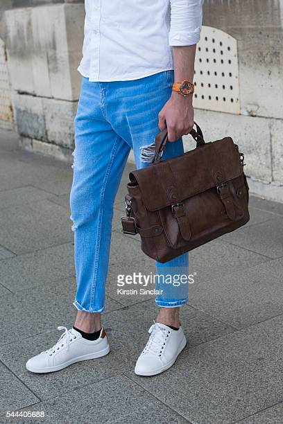 Model Sam Menant wears a Cafe Coton shirt Pull Bear jeans and trainers on day 3 of Paris Collections Men on June 24 2016 in Paris France Sam Menant