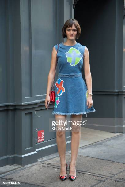Model Sam Rollinson wears a Henry Holland dress Chanel bag and Prada shoes on day 2 of London Womens Fashion Week Spring/Summer 2018 on September 16...