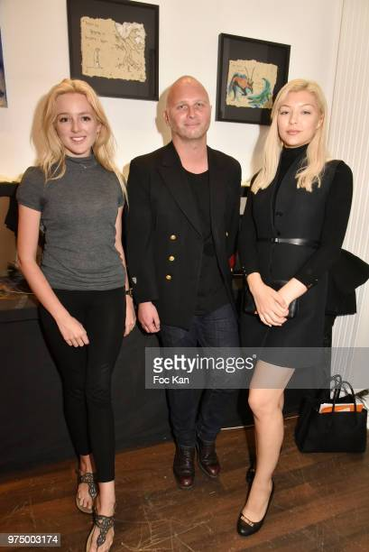 Model Samantha Kelly gallerist Romain Battaglia from Galerie de La Cle and Elizaveta Oleshko attend 'Kingdom Animalia' Roxane Depardieu Paintings...