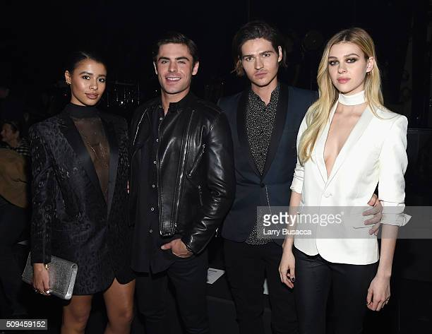Model Sami Miro in Saint Laurent by Hedi Slimane and actors Zac Efron Will Peltz and Nicola Peltz in Saint Laurent by Hedi Slimane attend Saint...