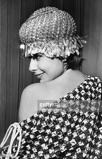 Model Sandra Russell wearing a braid straw Bathing Belle hat with straw fringe