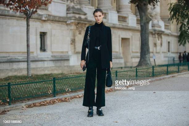 Model Sara Djkink wears a black jacket turtleneck pants and buckle boots during Paris Fashion Week Spring/Summer 2019 on September 29 2018 in Paris...