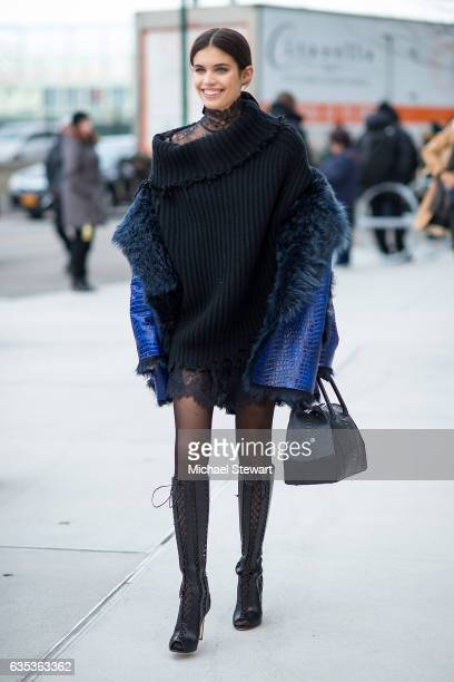 Model Sara Sampaio is seen wearing an Angelys Balek coat an Unravel sweater a Philosophy dress a La perla handbag Francesca Russo boots and Wolford...