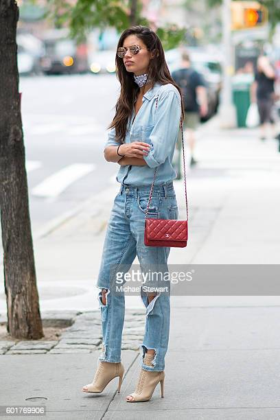 Model Sara Sampaio is seen wearing jeans from Citizens of humanity a bra from Victoria Secre boots from Gianvito Rossi and a Chanel bag on the...