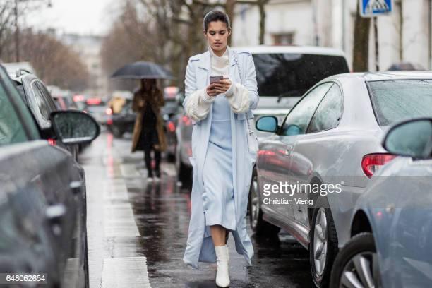 Model Sara Sampaio wearing a blue jacket dress outside Mugler on March 4 2017 in Paris France