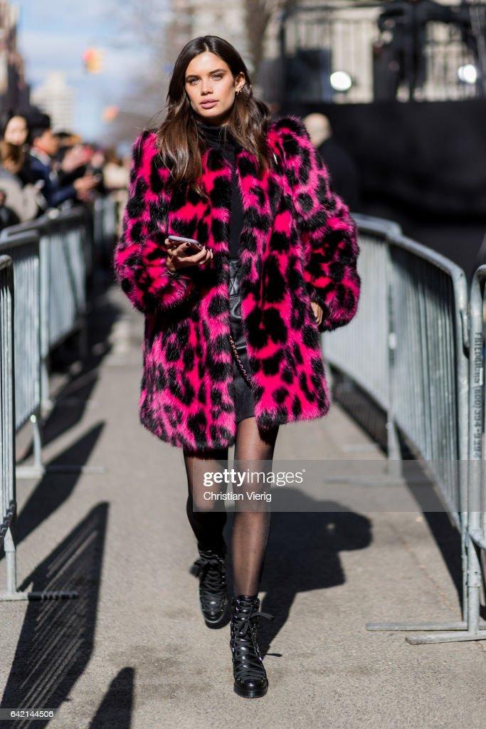 Model Sara Sampaio wearing a pink black leoprint coat outside Marc Jacobs on February 16, 2017 in New York City.