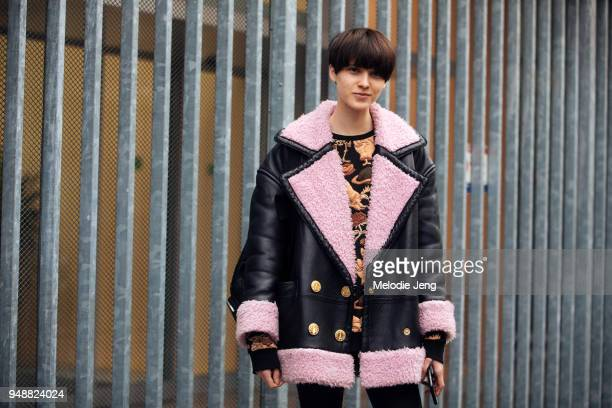 Model Sara Soric wears a black shearling bomber jacket with pink lining over a chinoiserie top during Milan Fashion Week Fall/Winter 2018/19 on...