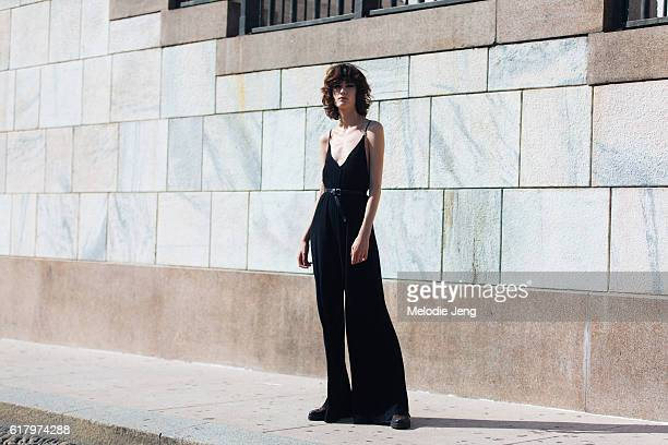 Model Sarah Boursin wears a black loose sleeveless widelegged jumpsuit after the Vivetta show during Milan Fashion Week Spring/Summer 2017 on...