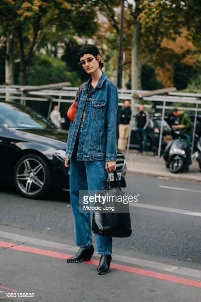 Model Sarah Boursin wears skinny sunglasses, a denim jacket and jeans during Paris Fashion Week Spring/Summer 2019 on September 28, 2018 in Paris,...