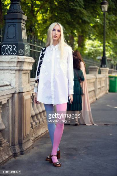 Model Sasha Komarova wears a white blouse with stars purple and pink tights and red heels after the Jean Paul Gaultier show during Couture Fashion...