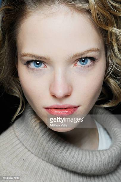 A model Sasha Luss is seen backstage ahead of the Max Mara show during the Milan Fashion Week Autumn/Winter 2015 on February 26 2015 in Milan Italy