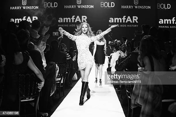 Model Sasha Luss walks the runway at amfAR's 22nd Cinema Against AIDS Gala Presented By Bold Films And Harry Winston at Hotel du CapEdenRoc on May 21...