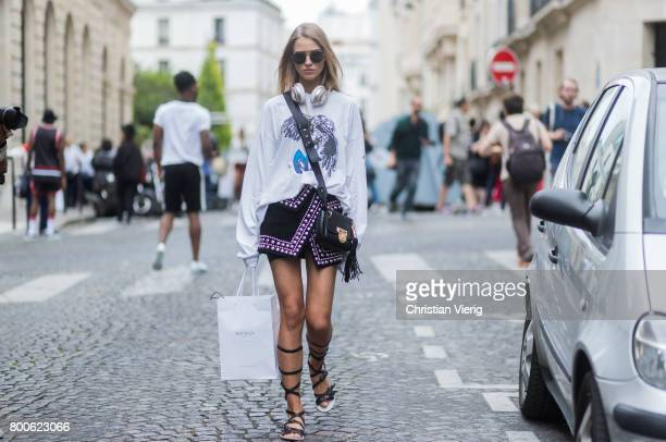 67e9c4d4b06c Model Sasha Luss wearing gladiator sandals white long shirt mini skirt  outside Balmain during Paris Fashion