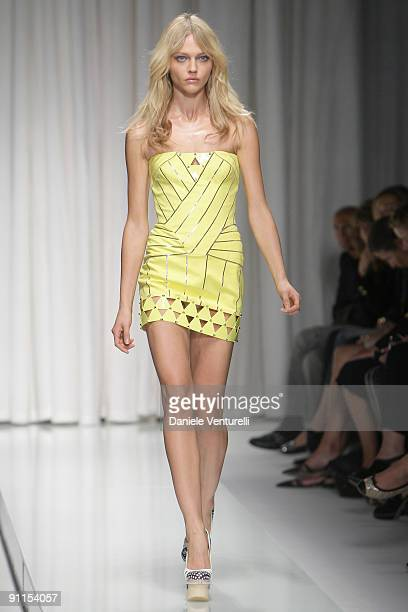 Model Sasha Pivovarova walks down the runway during the Versace show as part of Milan Womenswear Fashion Week Spring/Summer 2010 on September 25 2009...