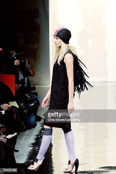 Model Sasha Pivovarova walks the runway at the Prada Autumn/Winter 2007 collection during Milan Fashion Week February 20 2007 in Milan Italy