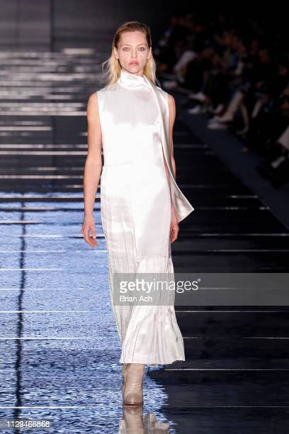Model Sasha Pivovarova walks the runway during the BOSS Womenswear Menswear runway show on February 13 2019 in New York City