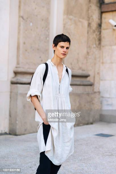 Model Saskia de Brauw wears a white tunic after the Alberta Ferretti Resort 2019 show at Milan Men's Fashion Week Spring/Summer 2019 on June 15 2018...