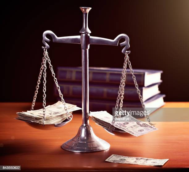 model scales of justice are weighted with banknotes - corruption stock pictures, royalty-free photos & images