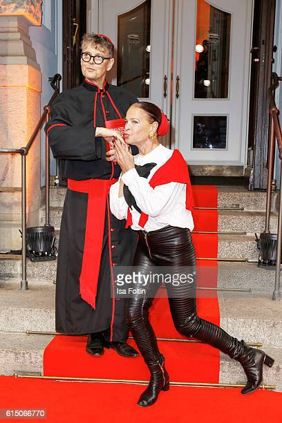 Model scout Rolf Scheider disguised as priest and german actress Barbara Engel attend the 'Sister Act The Musical' premiere at Stage Theater on...