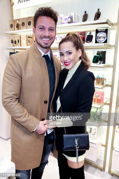 Model Sebastian Pannek and ReallityTV host Angelina Heger attend the Douglas FlagshipStore Opening on October 30 2019 in Berlin Germany