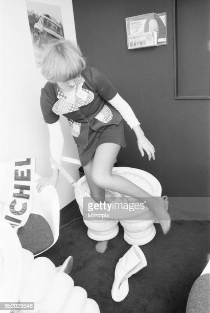 Model seen here putting on a Michelin man costume at the 1972 Motor Show at Earls Court 19th October 1972