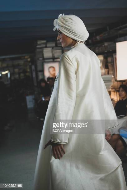 Model seen showcasing a design during the fashion week event. The Islamic Fashion & Design Council hosted a Milan Fashion Week Modest Soiree,...