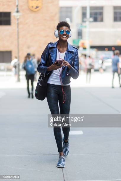 A model seen wearing a blue leather jacket in the streets of Manhattan outside Desigual during New York Fashion Week on September 7 2017 in New York...