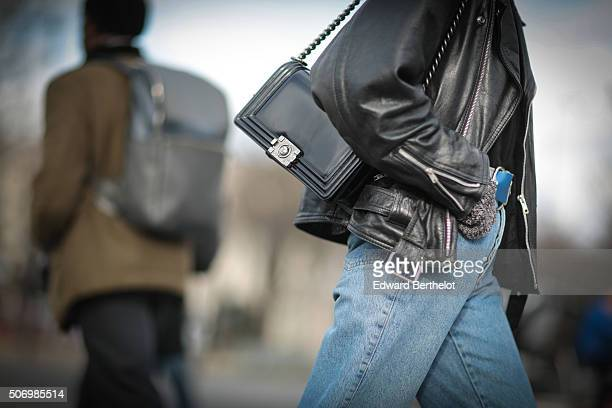 A model seen wearing a Chanel bag after the Chanel show during Paris Fashion Week Haute Couture Spring Summer 2016 on January 26 2016 in Paris France