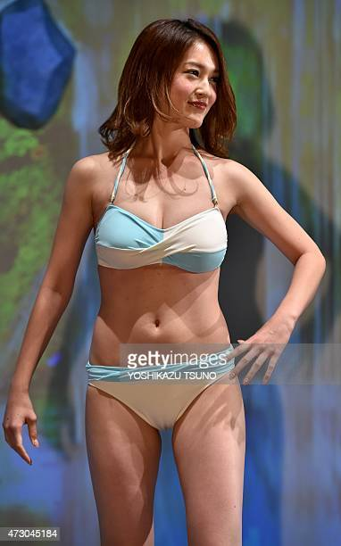Model Seira Miyazawa displays the latest swimsuit collection from Japanese apparel giant Wacoal's swimsuits brand Sanai in Tokyo on May 12 2015 AFP...