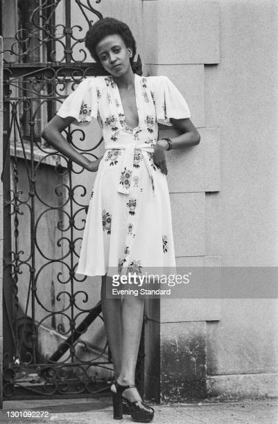 Model Selina wears a floral dress by English fashion designer Ossie Clark, UK, 16th July 1973.